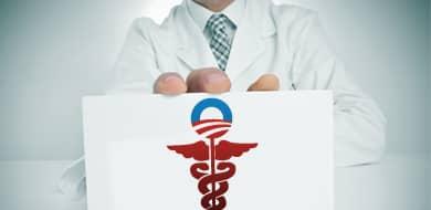 doctor holding up Obamacare sign