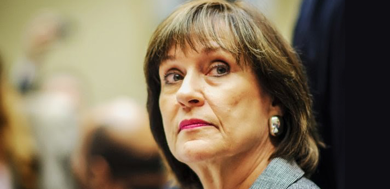 Lois Lerner looking to side, blurry background
