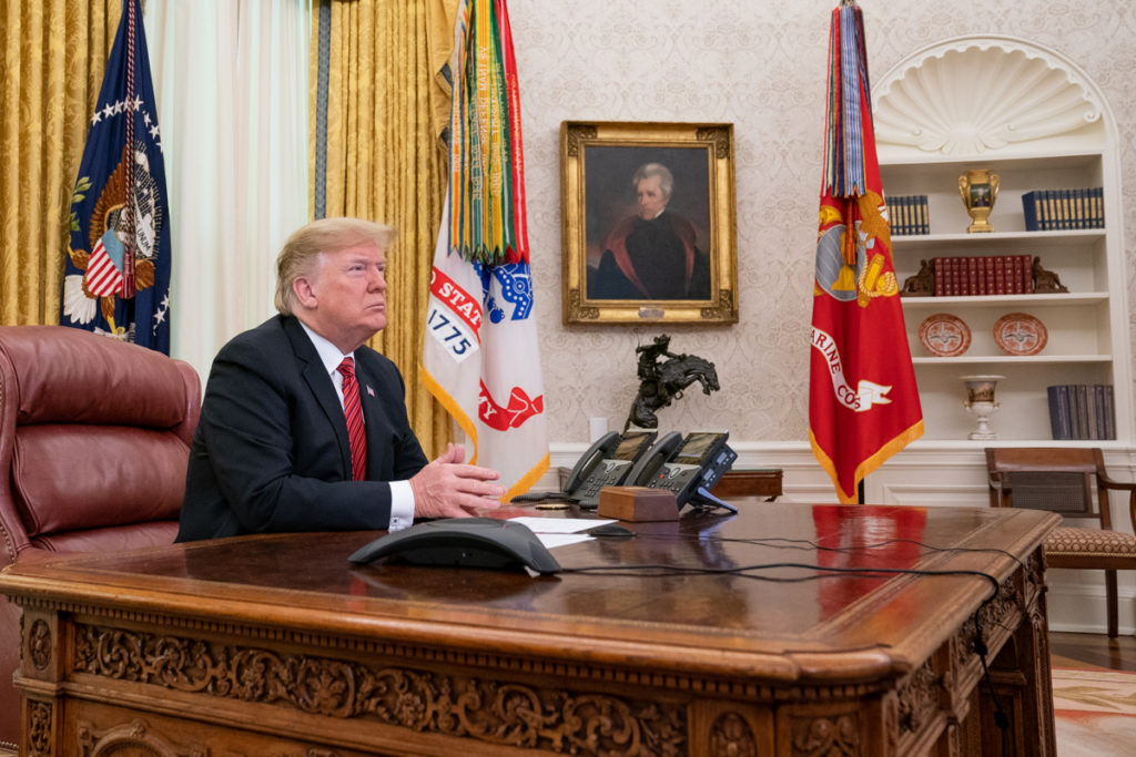 President Donald J. Trump participates in a Christmas Day video teleconference from the Oval Office Tuesday, Dec. 25, 2018, with military service members stationed at remote sites worldwide to thank them for their service to our nation. (Official White House Photo by Shealah Craighead)
